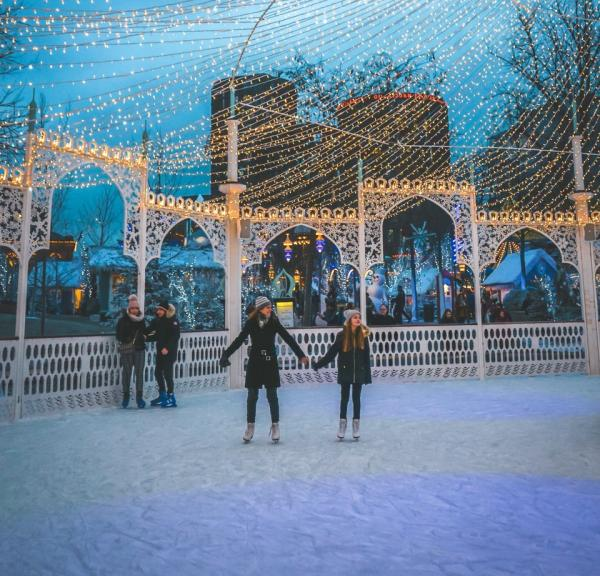 Ice skating in front of the magical Nimb Hotel in the iconic Tivoli Gardens