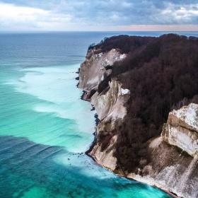 Møns Klint, a cliff in Southern Denmark, seen from above, with turquoise waters